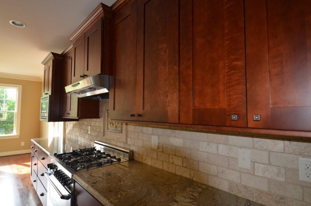 shaker cognac cabinets, kitchen cabinet value